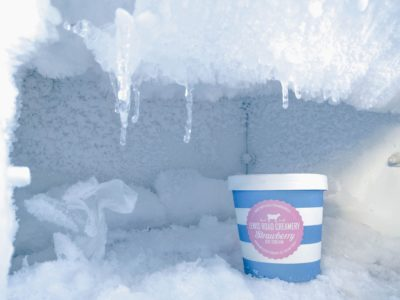 A cup of ice cream in the freezer.