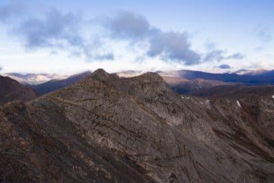 A rocky mountain under the sky.