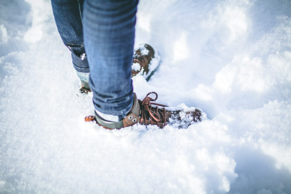 A person wearing boots in the snow.