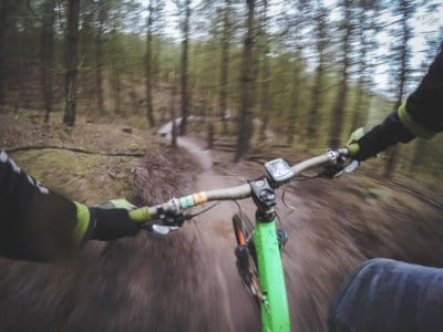 Riding a bike in the woods.