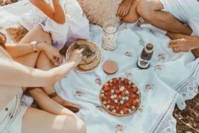 People having a picnic outside.