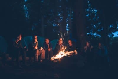 People around a campfire at night.