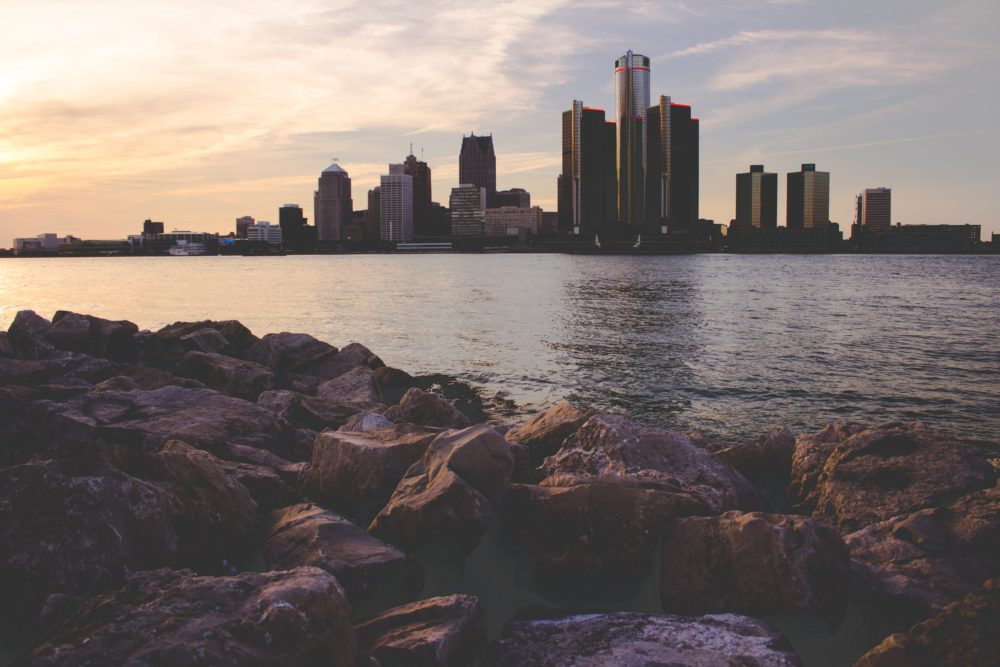 The Detroit skyline by the water daytime.
