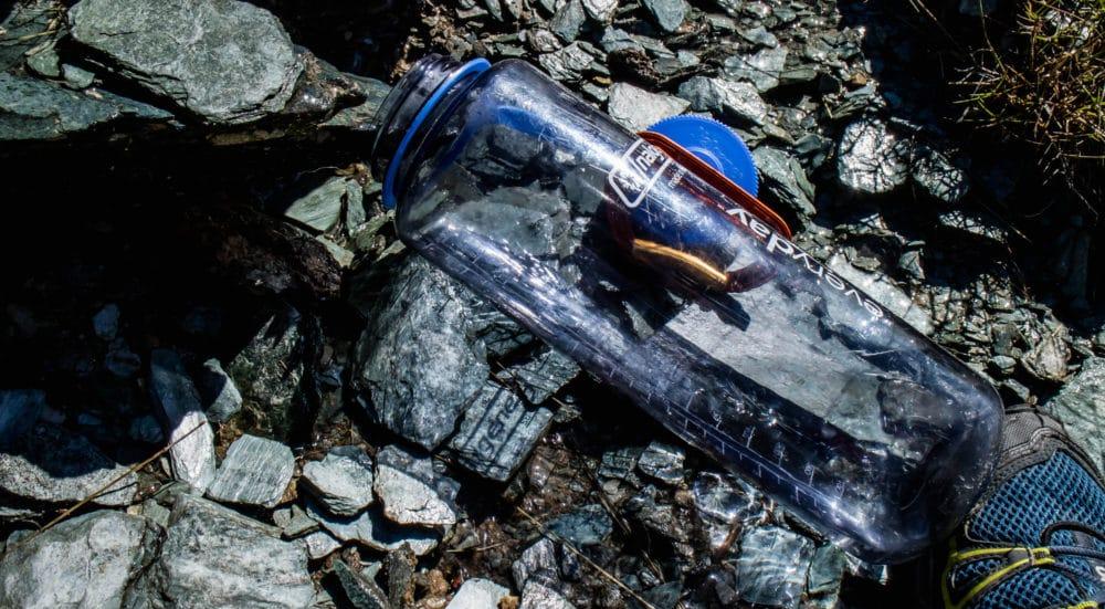 A Nalgene bottle on some rocks.