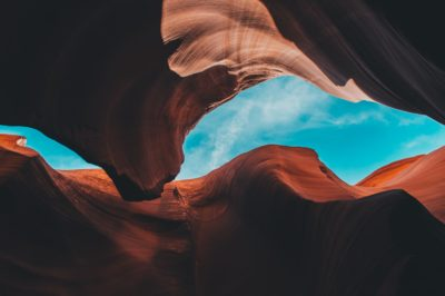 Blue sky seen through a canyon.
