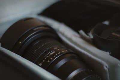 A camera lens in a camera bag.