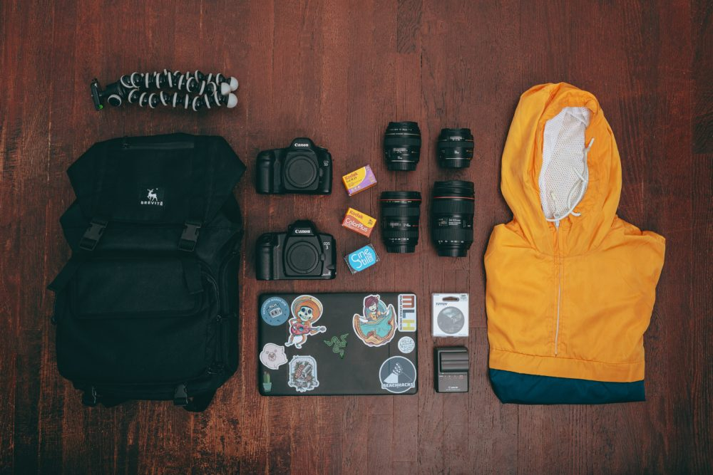 A camera bag and a yellow rain jacket.