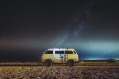 A van in the desert at night.