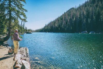 A man fishing on a lake.