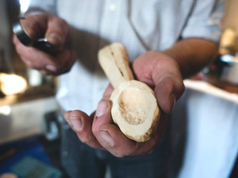 A person whittling.