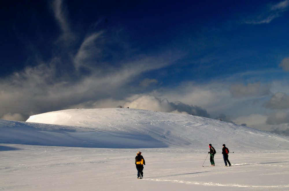 People hiking in the snowy mountains