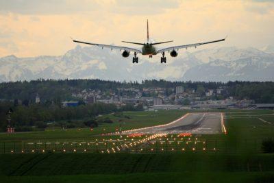 A plane taking flight daytime.