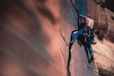 A man climbing up a rock face.