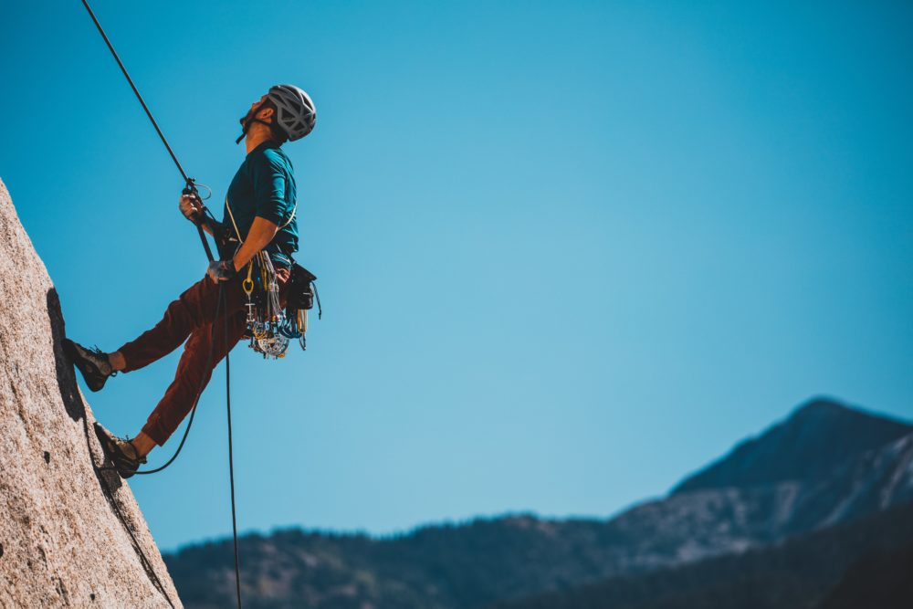 A man climbing on a mountain.