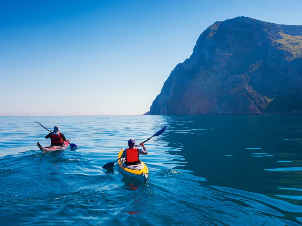 People kayaking in the sea.