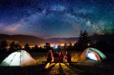 People camping at night.