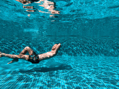 A man swimming in a pool.