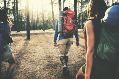 People hiking in the woods.