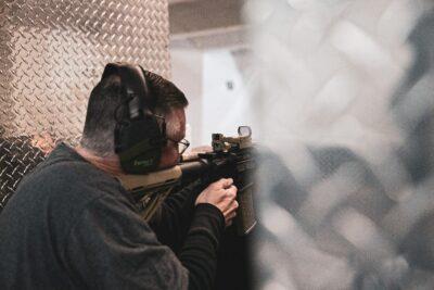A man shooting a rifle.