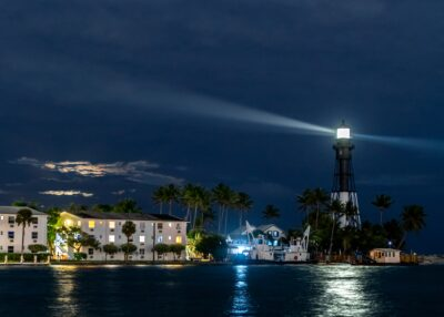 A lighthouse on the water at night.