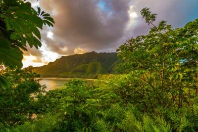 The sun rises into the Kahana valley at Ahupua?a ?O Kahana State Park