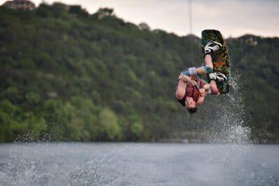 A man water boarding in Lake Austin.