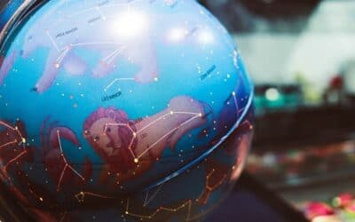 a globe with zodiac constellations on it
