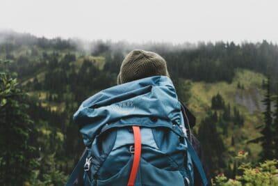 a backpacker wearing a tarp