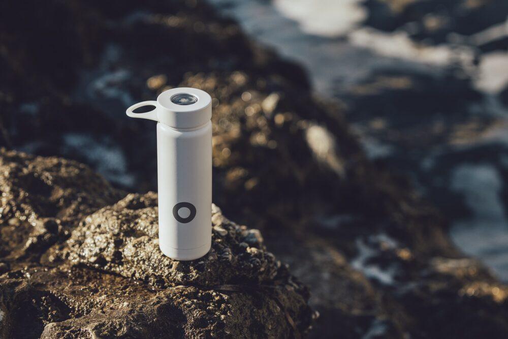 a water bottle on a rock