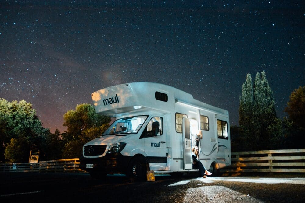 RV parked on the highway at night