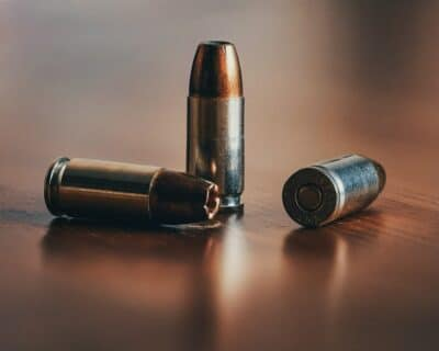 3 bullets on a wooden table