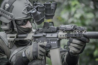 a military soldier holding a gun