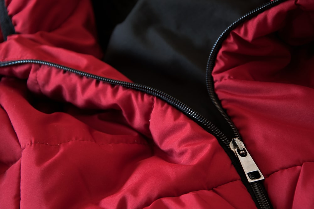 Close up of red down jacket, winter fashion outfit