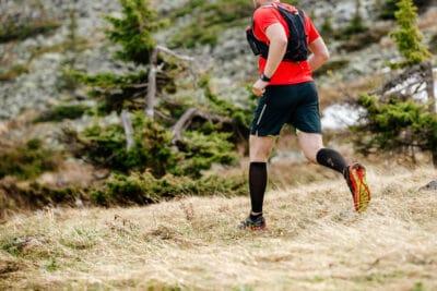 male runner with camelbak