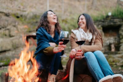 two women camping and laughing