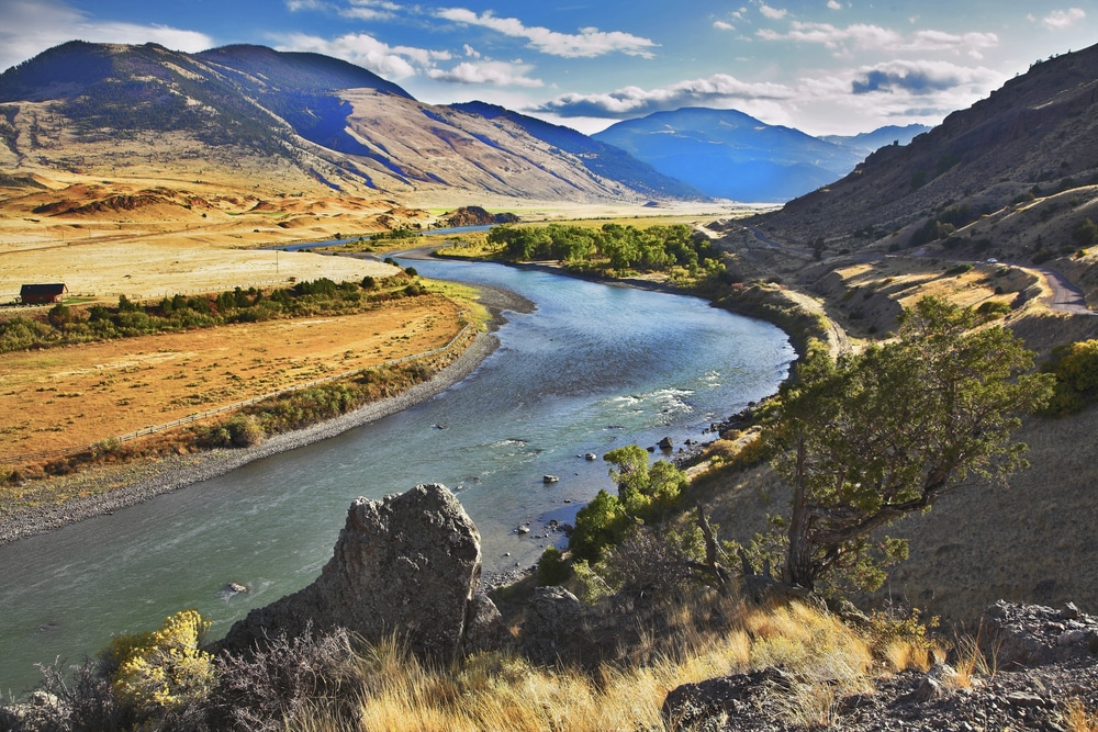 river Missouri smoothly flows between picturesque hills