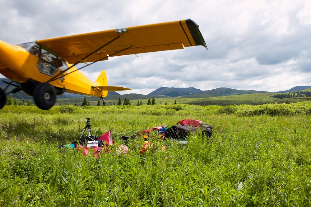 camping gear and an airplane in a field
