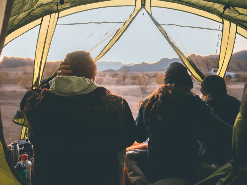 a group of people in a camping tent
