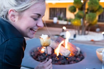 Roasting marshmallow over a gas fire