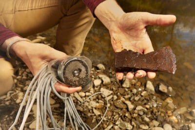 Man found rusty iron metal axe in river water by magnet
