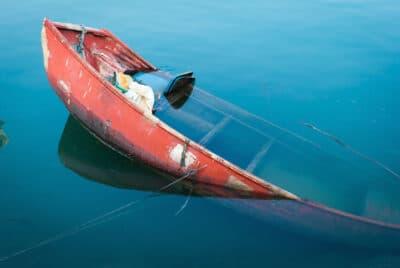 Shipwreck in fish boat port