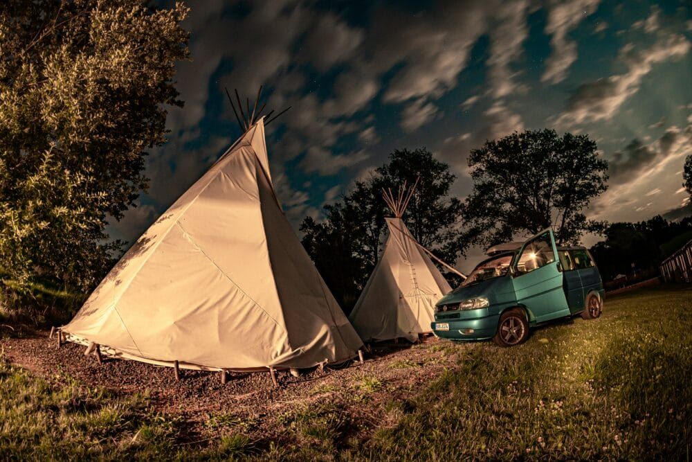 Volkswagen T4 caravelle at night near the teepee tents